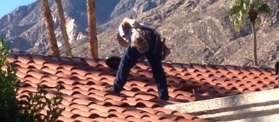 Tile roof being worked upon