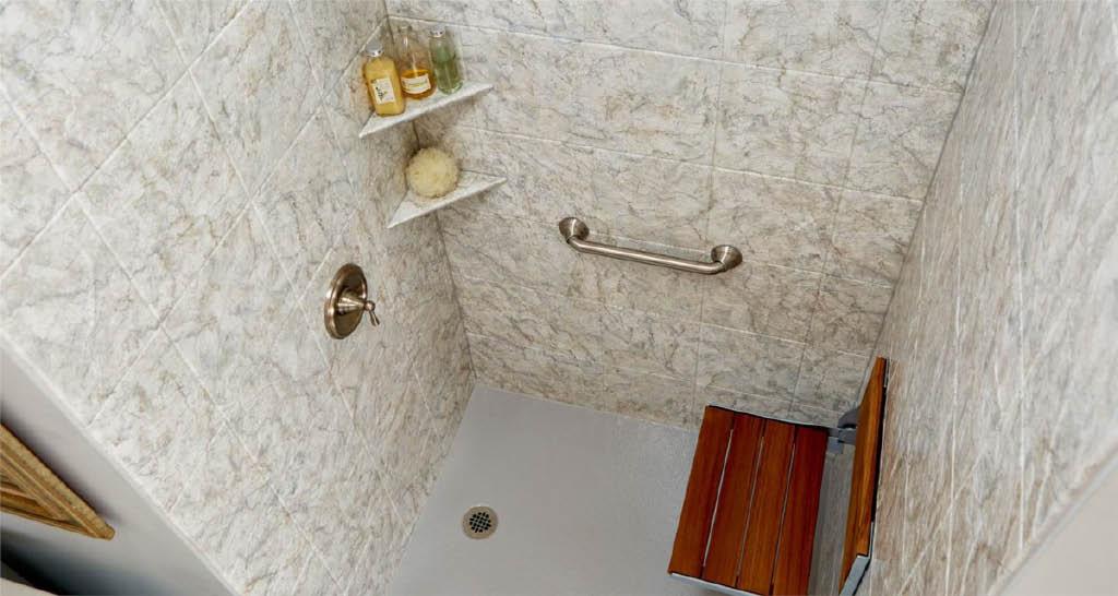 Patterned bath surround on white tub.