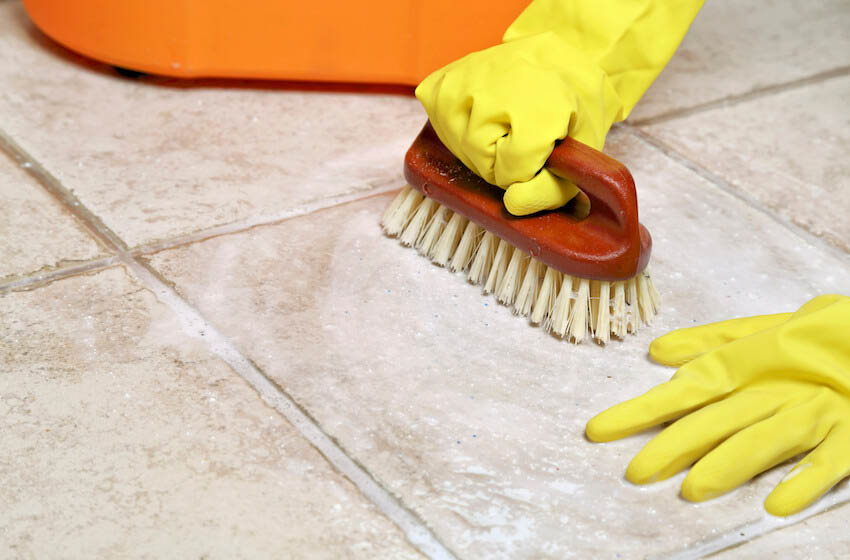 maid scrubbing floor