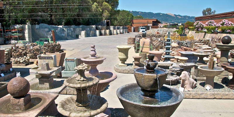 outdoor display of yard and decorative fountains; pavers, stone; patio supplies; Richert Lumber Ace Hardware in Pleasanton, CA