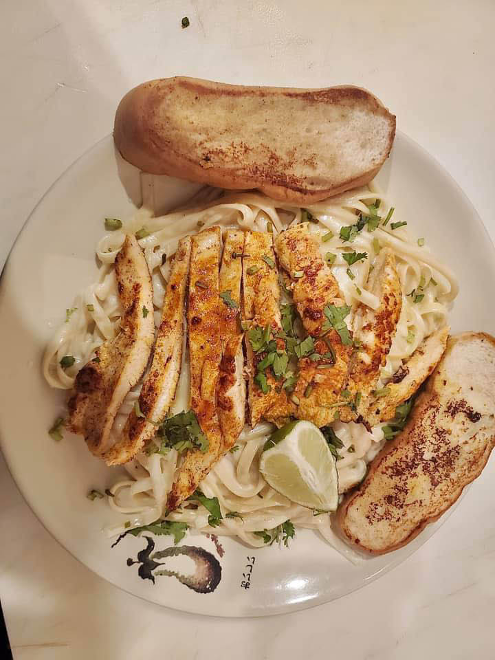 Chicken over noodles at Sabor Latino