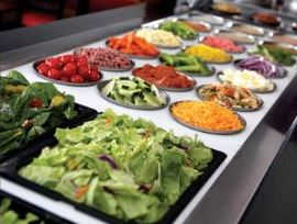Salad bar is stocked with fresh ingredients daily.