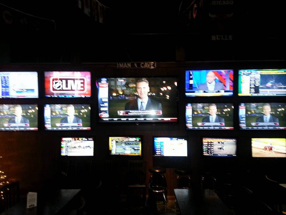 Tv's over bar at Sam's Triple Crown Sports Bar.