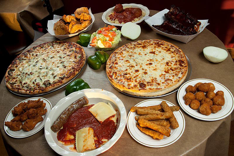 Photo of Menu Items Pizza Ravioli Chicken Wings Fried Zucchini Fried Mushrooms Broasted  Chicken Salad Ribs