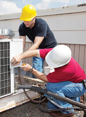 heat pump repairmen at work in Stillwater, MN; Schwantes Heating and Air Conditioning