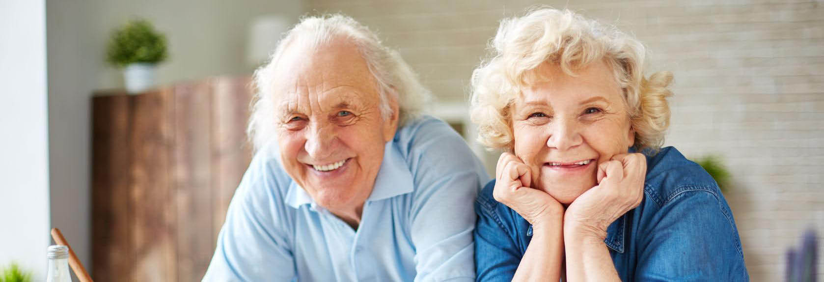 Senior couple smiling together with better hearing.