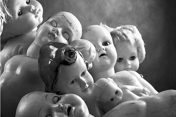 Photo of old porcelain dolls in a pile in Milwaukee, WI