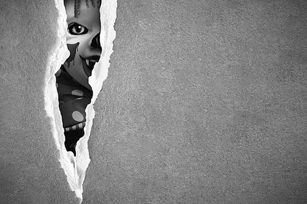 Picture of a scary figure peeking through a crack in Racine, WI