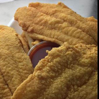 Seasoned breaded fish fillets at Sharks Seafood in Blue Island!