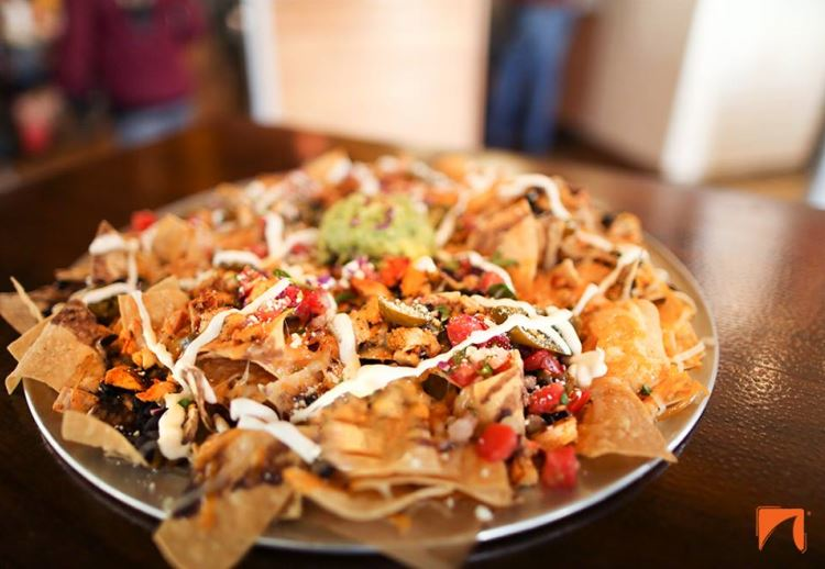 A healthy stack up of nachos made from whole ingredients