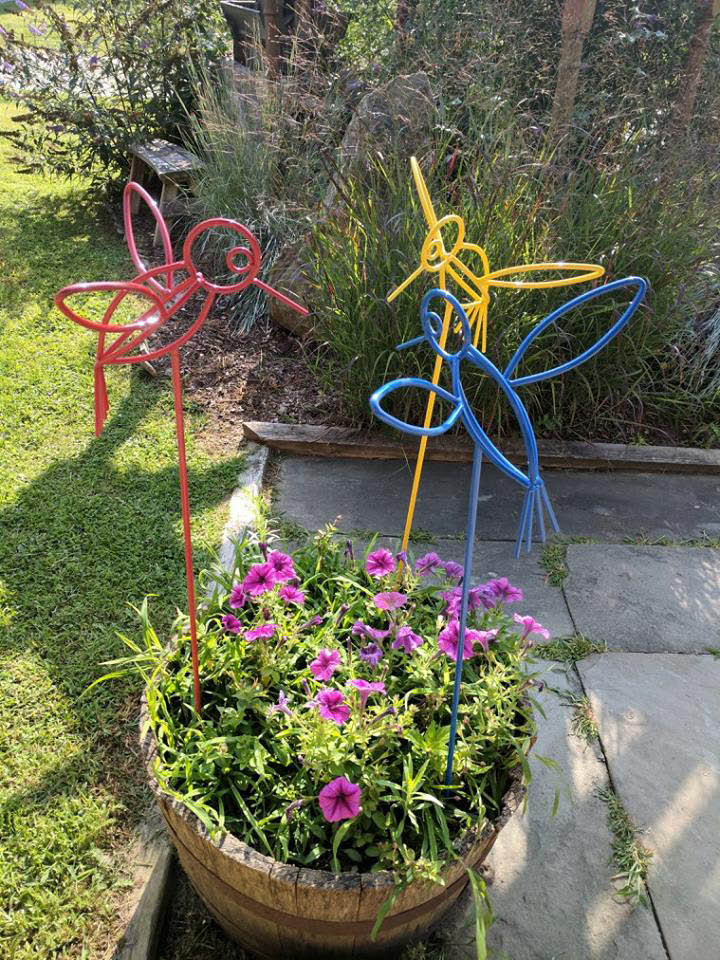 All types of outdoor decor including weather vanes, decorative copper and iron items, lawn art