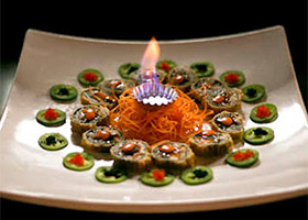 circular display of sushi on a square platter