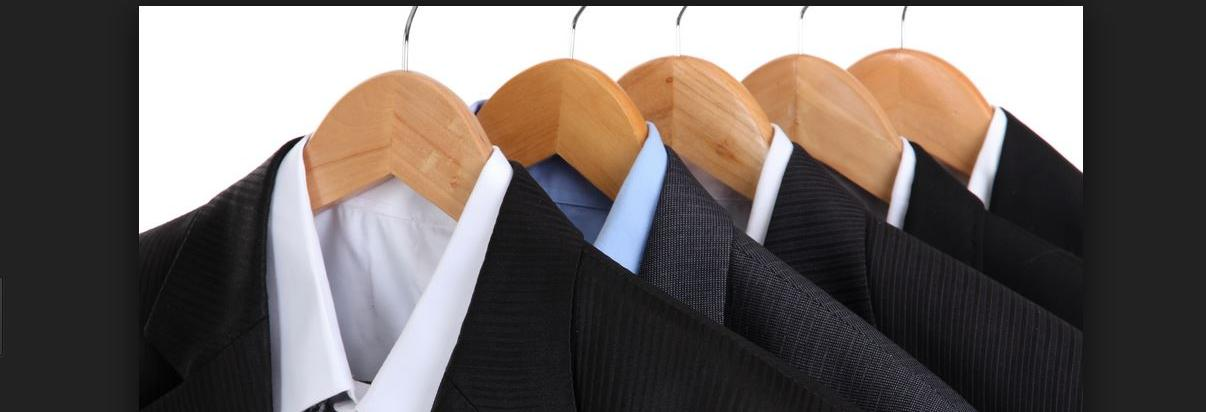 Five men's suits and shirts on wood hangers