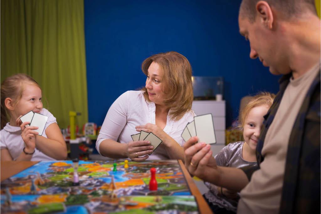 family having fun playing a board game