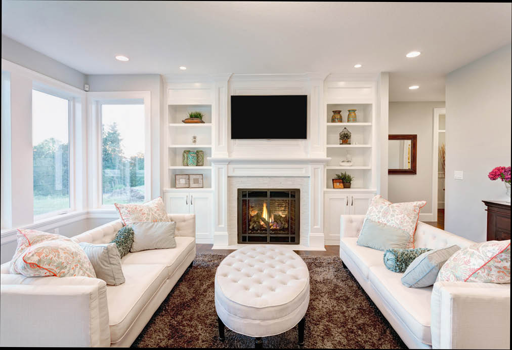 clean living room with white walls and white furniture cleaned by Simply Pure Home green house cleaning service