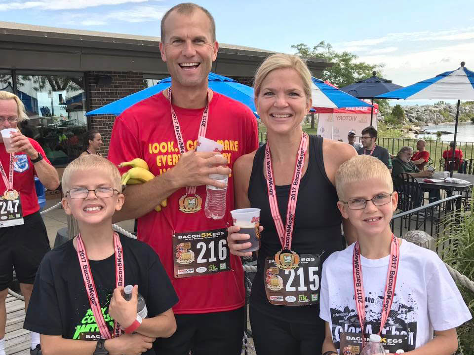 Running family posing for a picture after the race.