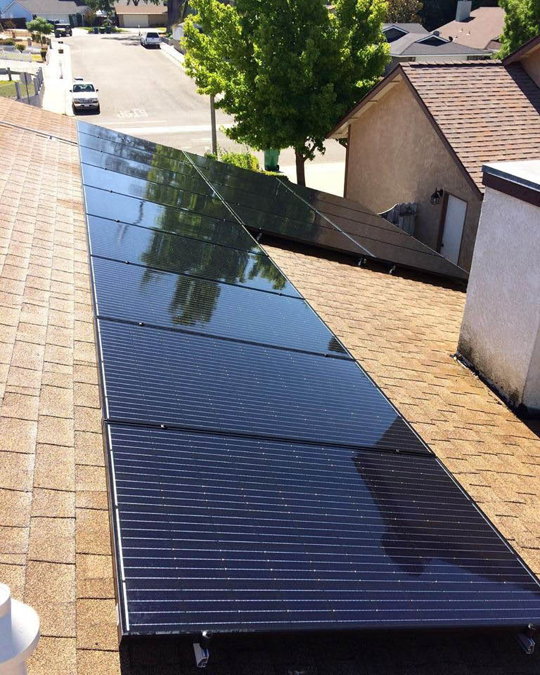 solar panels on top of house in California; solar energy