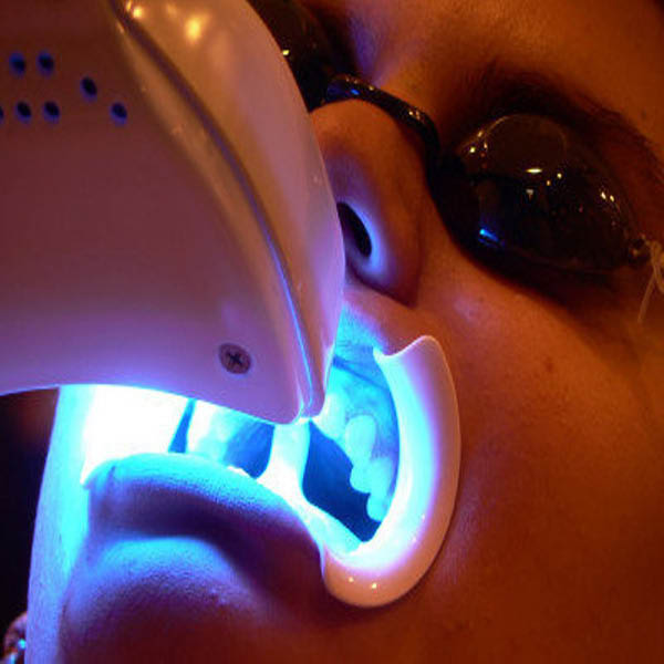 Receive a whiter, brighter smile with professional teeth whitening
