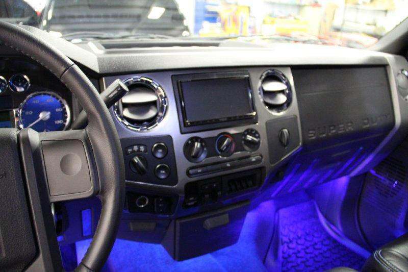 Providing Car Audio, Mobile Audio, Amplifiers, Car Stereo, Car Audio Installation and car Lighting in Racine, WI. Photo is what a neon lighted car interior looks like.