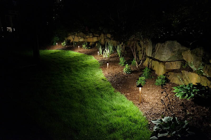 Landscape lighting is inviting and functional for those arriving at night