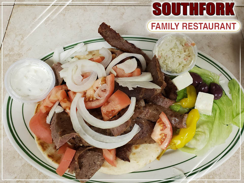 Gyros plate served for lunch plus other sandwiches.