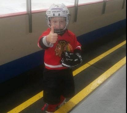 Little hockey player giving thumbs up at St Jude learn to skate session.