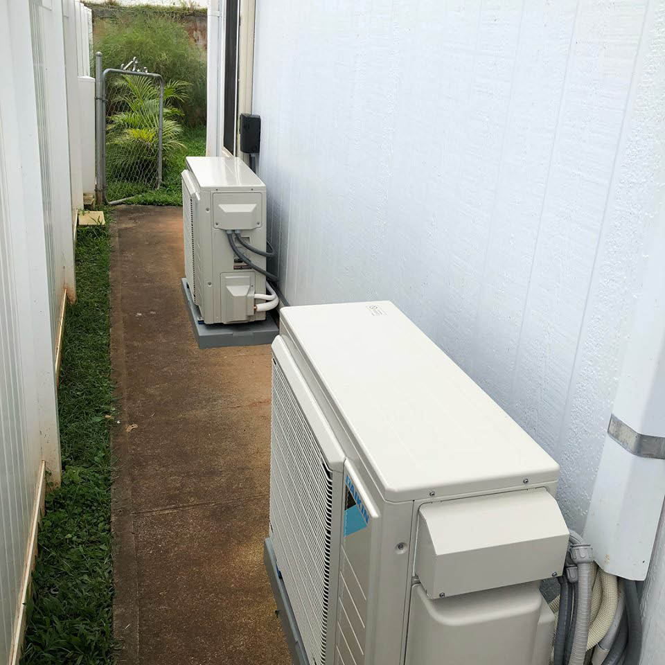 Air conditioning units next to house