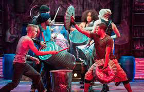 Dancers and actors performing in Stomp