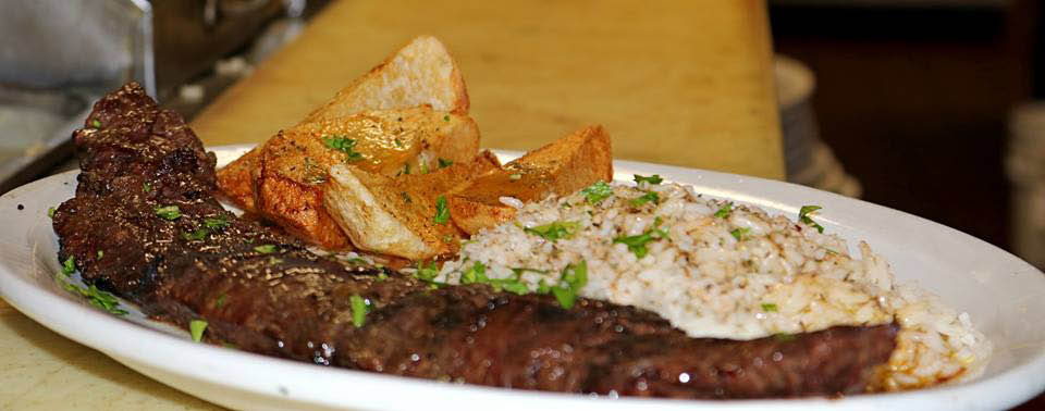 Enjoy a NY stripsteak at Les Brothers restaurant!