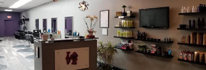 The Studio 787 salon showing stylist's chairs and hair products on shelves