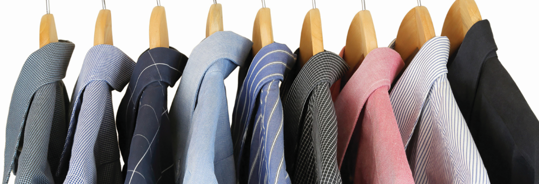 Dry cleaned and pressed shirts on hangers banner