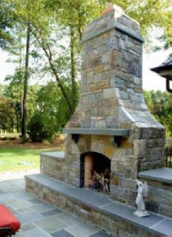 Custom made outdoor fireplace with stone detail
