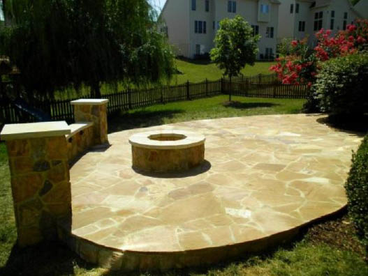 Stone patio in the backyard with outdoor fire pit