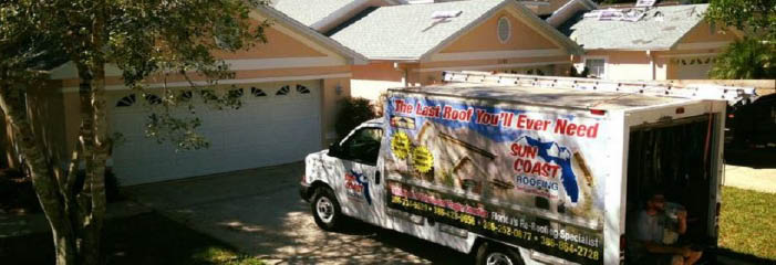 Our Sun Coast Roofing truck at a house after installing a new roof