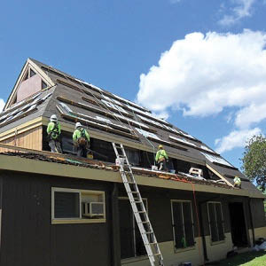 Adding a new roof to help guarantee leak prevention in Palolo