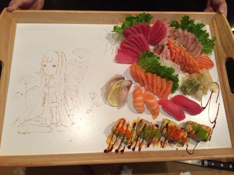 Sashimi and sushi platter with original drawing near Brookshire