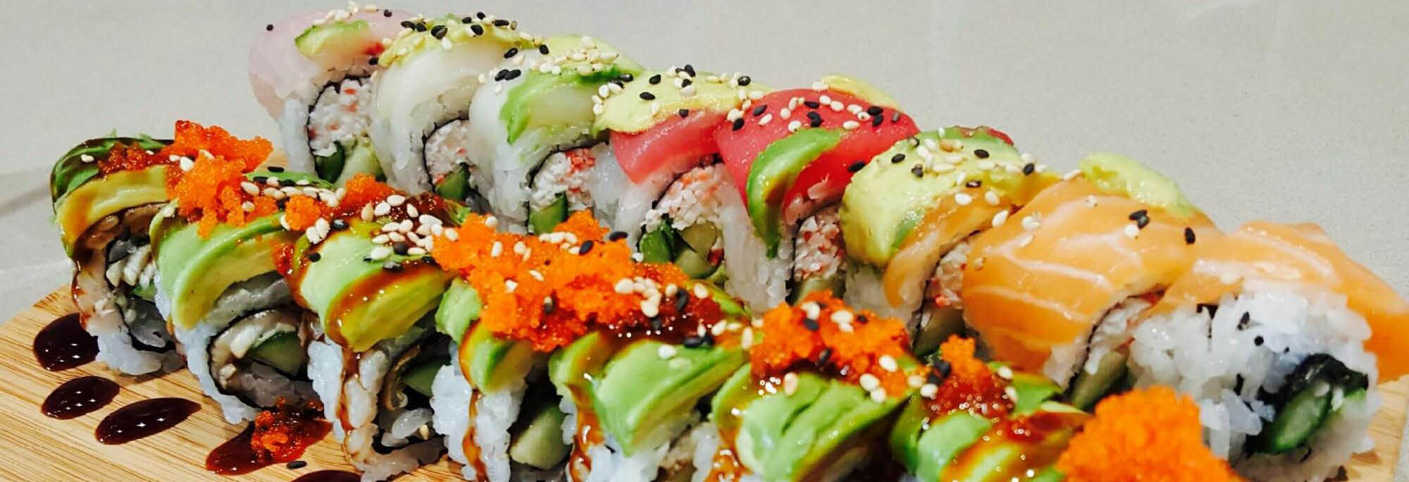 Fresh and beautifully presented sushi rolls banner