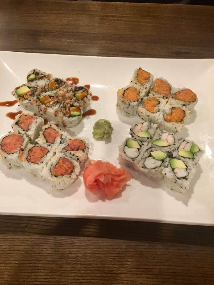 Fresh sushi rolls with wasabi and ginger