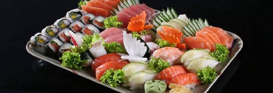Display of hand rolled sushi and fresh sashimi at Taste of Tokyo banner