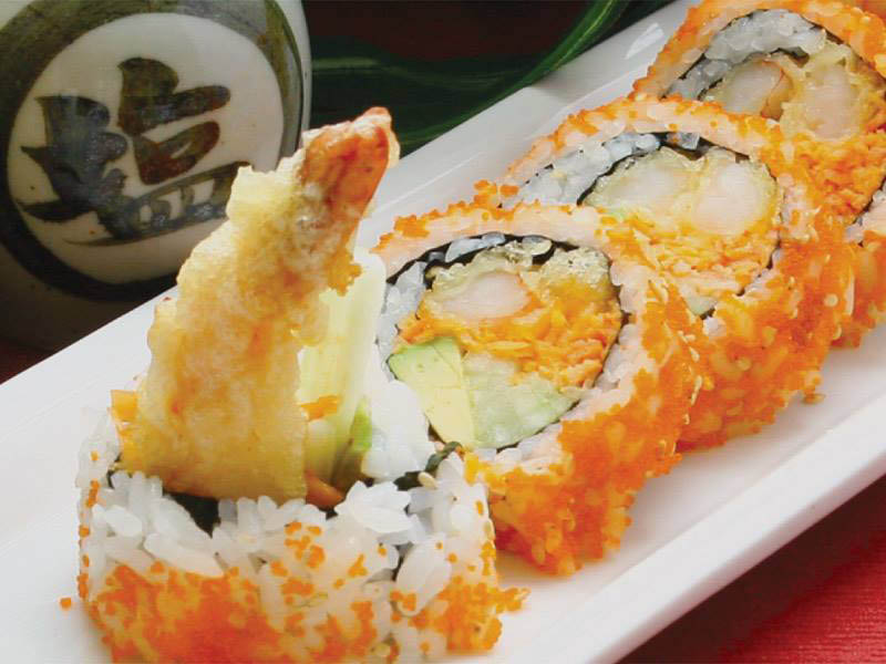 Crispy tempura shrimp, rice, veggies and fish roe hand roll