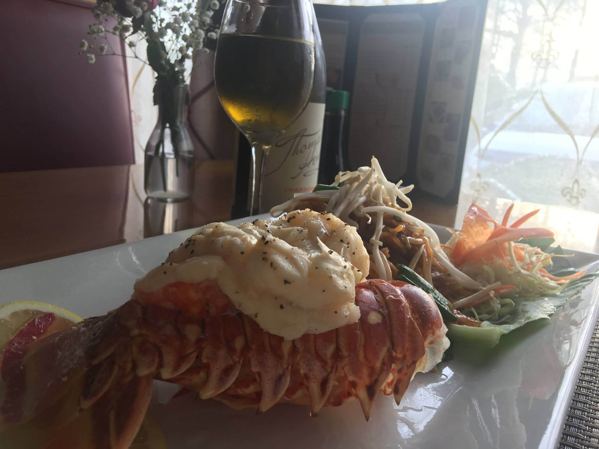 Fresh caught lobster dinner with a white wine accompaniment