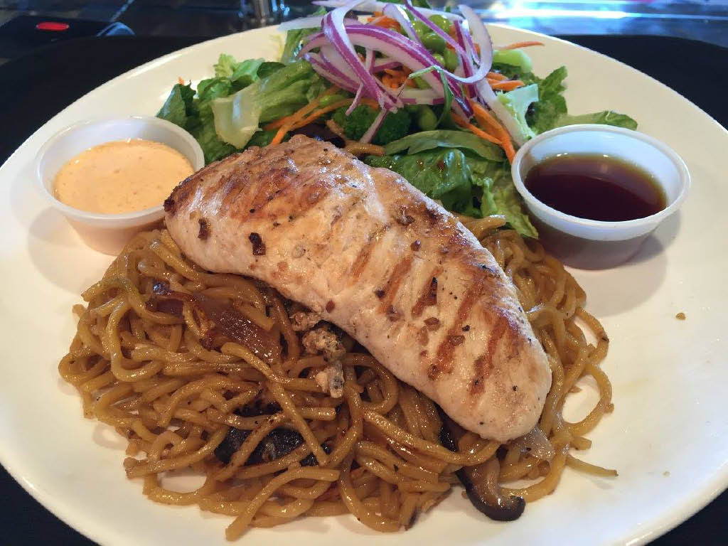grilled teriyaki chicken over noodles with side salad and dressing; Teriyaki House Ankeny