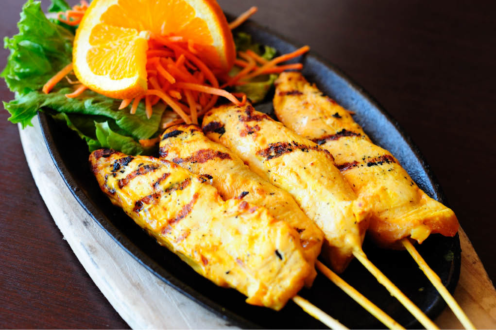 Chicken kabobs with oranges and carrots