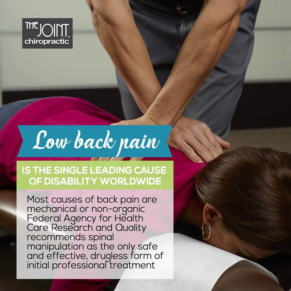Low back pain adjustment being performed