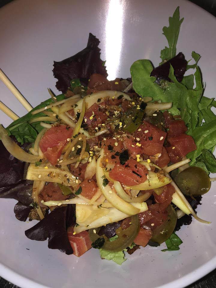 Fresh poke salad with pickled vegetables
