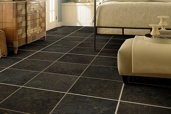 Tile floors add texture and a natural outdoor look to interior rooms; durable flooring at Carpetland in Wisconsin