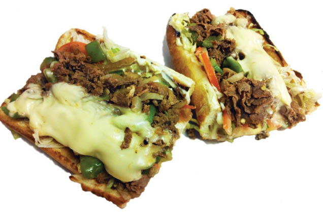 roast beef sandwich with peppers and cheese