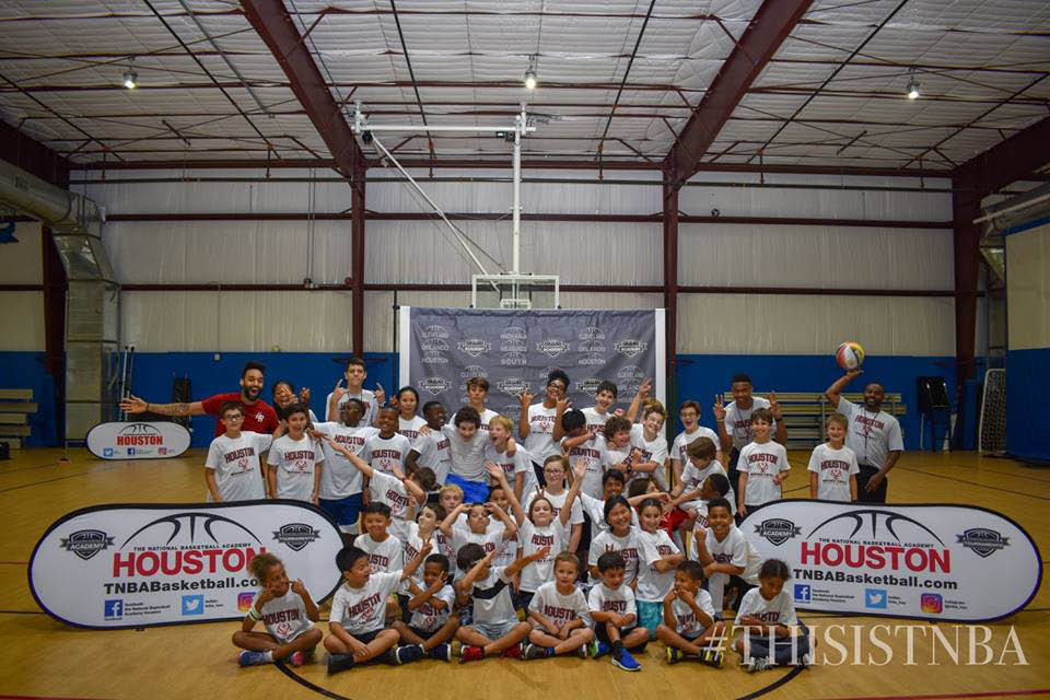 basketball training camp for youth; group photo of basketball camp coaches and participants