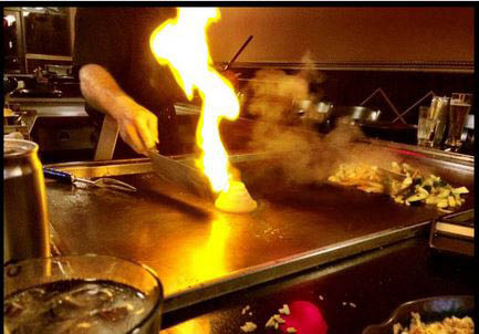The flaming Hibachi grill allows foods to be cooked at your table