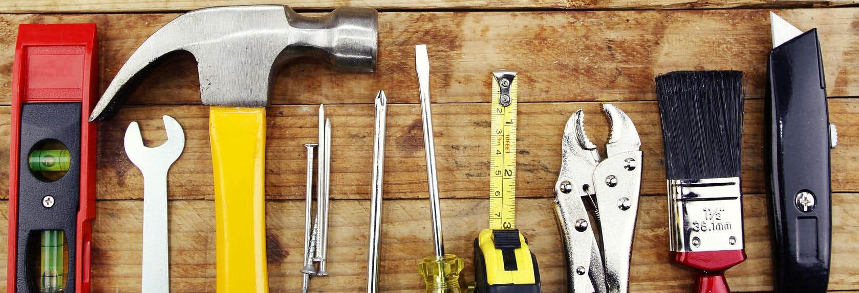 Handyman fixing cabinet. Gallagher Handyman On Demand fixes small jobs.